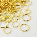 Paquete de argollas de tamaños entre 4 a 10 mm color dorado
