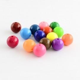 Perlas acrilicas en colores variados. 6mm