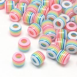 Perlas de colores con rayas. Material Resina